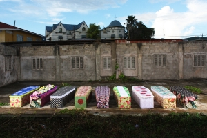 Ebony G. Patterson  9 of 219, Installed in a Yard in Port-of-Spain, Trinidad, Multi-Media Perfmative Project with Embellished Coffins ( 6ft x2ft x12 in) with Sound, 2011, Image Coutersy of Rodell Warner