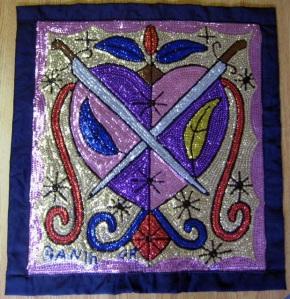 Drapo haïtien  https://aica-sc.net/2015/01/07/drapo-tapisseries-de-sequins-dhaiti/