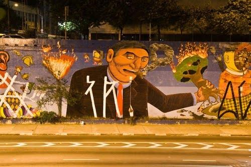 Mural OSGEMEOS et Nunca, Sao Paulo, 2012, tagué par le gang Krypta. Sur blog : https://grafitebrasil.wordpress.com/2010/03/30/4/1269357903254_f-2/